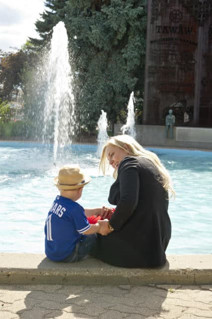 with son by fountain